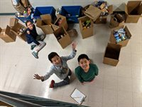 CMS Community Service Club members sort and box food items