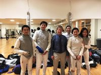 Members of the BHS Fencing Team with BHS Asst. Principal and Fencing Coach Tom Brow