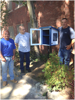 Butler Little Free Library with Facilities Staff
